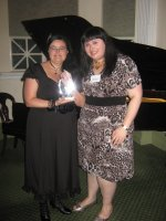 Lami Mentzas accepts JR Ward's trophy from Sofia Morales, Galaxy Bookshop